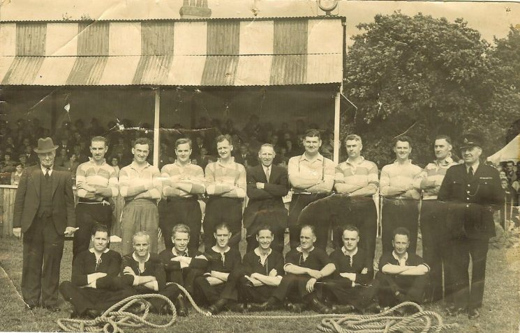 Tug-of-war teams believed at Kingsholm, Gloucester. Back row left to right: Superintendent Soldier, Harry Thomas, unknown, V Batstone, Morris, H Olpin, W Newman, A Savage, I Dimery, unknown, J Halllam. Front Row left to right : Williams, W Workman, Newman, King, R Sandle, H (Harry) Gribble, unknown, A Tucker, F Taylor. Further research suggests that this was taken in 1946 at the first Constabulary Sports Day after the war and if so this would be at The Wagon Works and not at Kingsholm. (Gloucestershire Police Archives URN 1578)