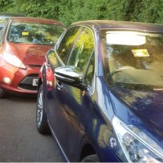 Cars were parked illegally at Woodchester May 2020. (Gloucestershire Police Archives URN 10776-27)